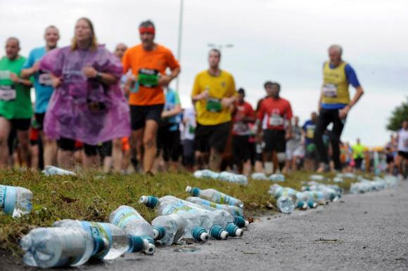 Empty water bottles litter the roads as tired runners reach the half way point during the 2012 Bupa Great North Run this morning (Sun), with 55,000 entrants competing in the world's biggest half-marathon. Words to follow from Nova International. © North News & Pictures ltd